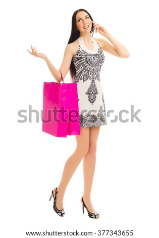 Woman with mobile phone and bags