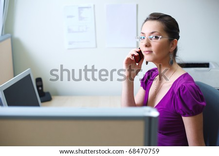Woman with mobile phone at office in casual clothes - stock photo