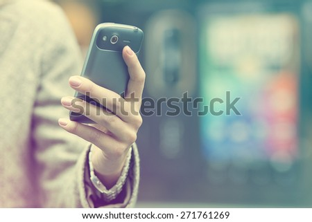 Woman with mobile phone in hand - stock photo