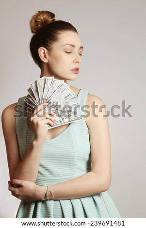 Woman with money, Fashion portrait of young woman with bunch of dollar bills - stock photo