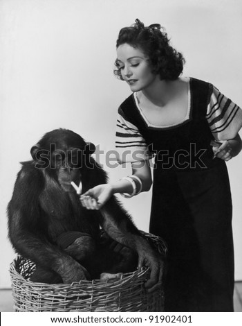 Woman with monkey - stock photo