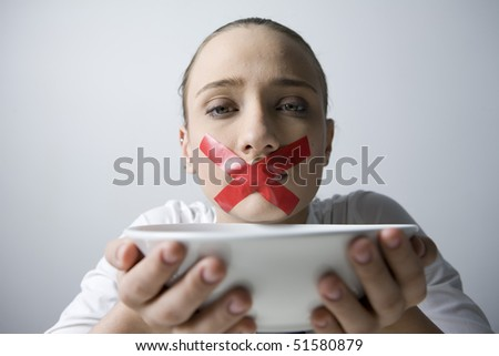 Woman with mouth gagged
