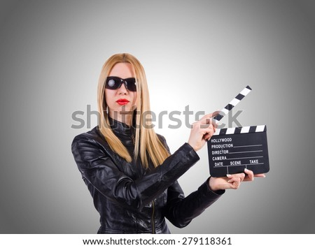 Woman with movie clapper on white - stock photo