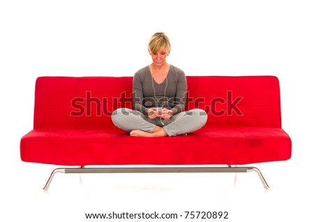 woman with mp3 on the sofa