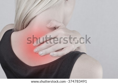 Woman with neck and back pain. Woman rubbing his painful back close up. Pain relief concept - stock photo