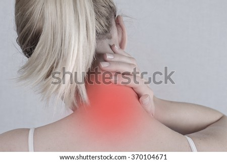 Woman with neck pain close up. Pain relief,  chiropractic concept - stock photo