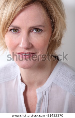 Woman with neutral expression. - stock photo