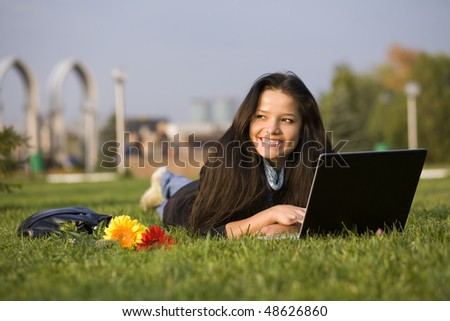 Woman with notebook at the summer park - stock photo