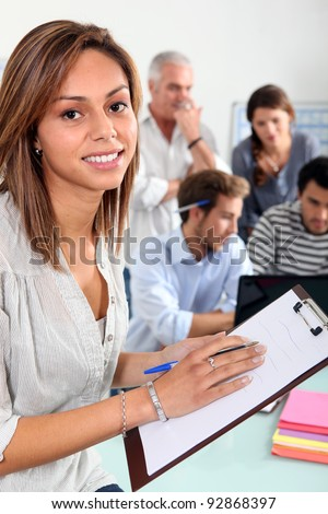 woman with notepad in classroom - stock photo