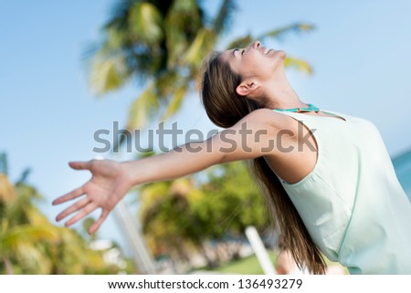 Woman with open arms enjoying her freedom