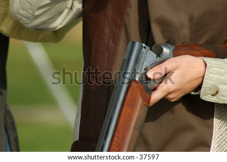 woman with open shotgun on a trap range - stock photo