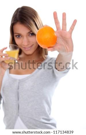 Woman with orange juice - stock photo