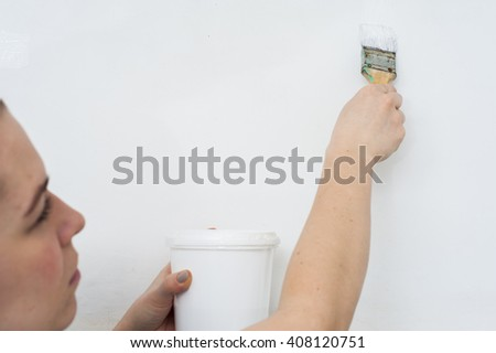 Woman with paint can and brush