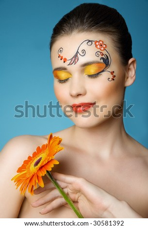 woman with paint of khokhloma on her head - stock photo