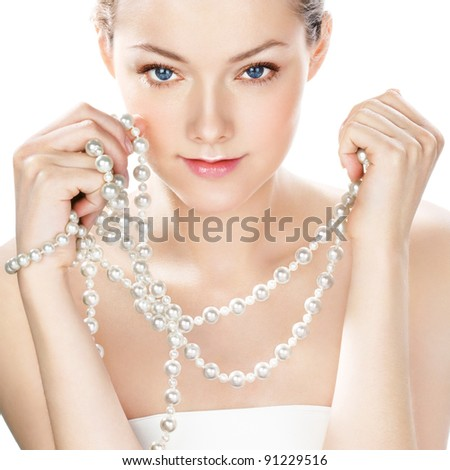 Woman with pearl jewelry - stock photo