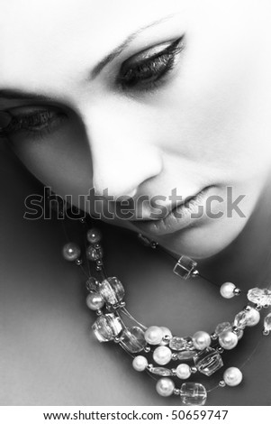 Woman with pearl necklace - stock photo