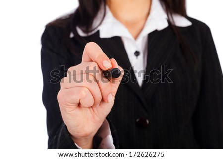 Woman with pen drawing on virtual wall, board. - stock photo