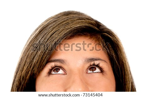 Woman with pensive eyes looking up - isolated over white