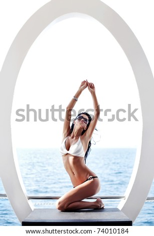 Woman with perfect body lying and relaxing on yacht - stock photo