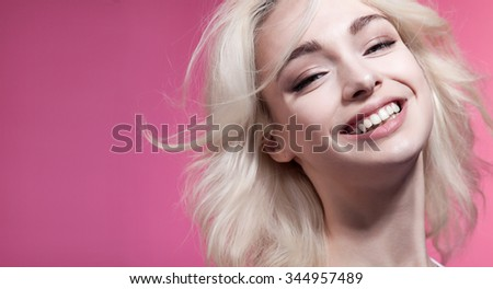 Woman with perfect smile and blond hair - stock photo