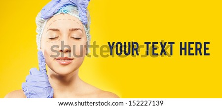 woman with perforation lines on face before plastic surgery - stock photo