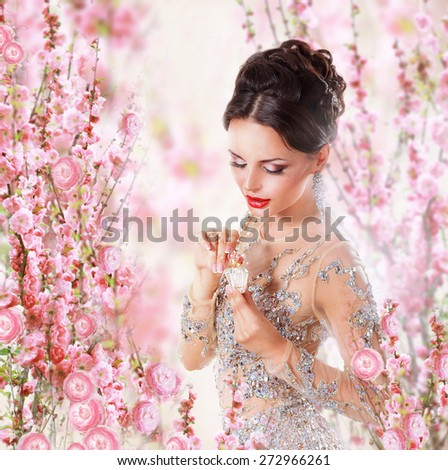 Woman with Perfume over Floral Background - stock photo