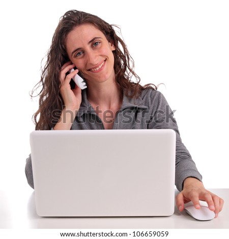 woman with phone and computer