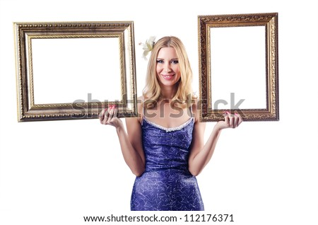 Woman with picture frames on white - stock photo
