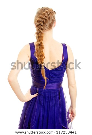 Woman with pigtail in blue dress from the back. Isolated on white.