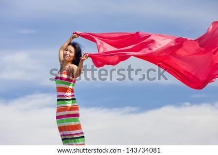 Woman with pink cloth. - stock photo