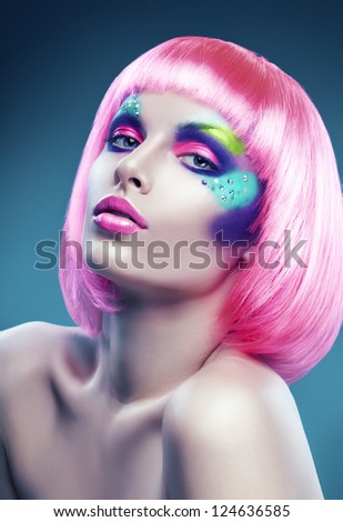 woman with pink hair and colourful make-up - stock photo