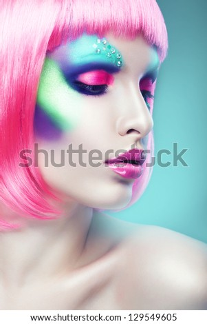 woman with pink hair and lips in blue light