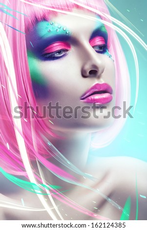 woman with pink hair in blue light and lines - stock photo
