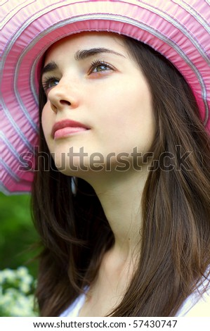 Woman with pink hat