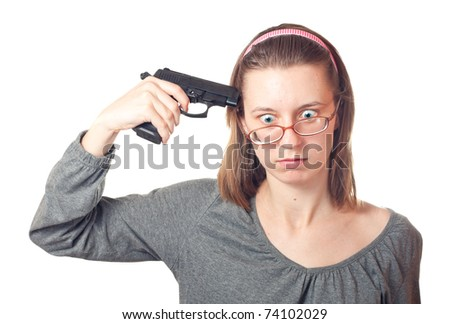 Woman with pistol pointing on her head, isolated on white. - stock photo