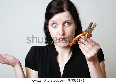 woman with pliers is overwhelmed