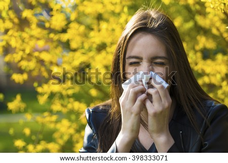 Woman with polen allergy over flowers - stock photo