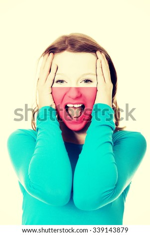 Woman with Polish flag painted on face. - stock photo