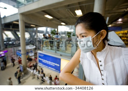 woman with protective mask at the international airport in bangkok - stock photo