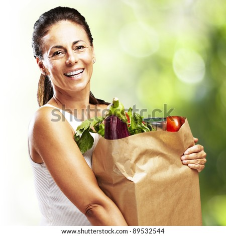woman with purchase against a nature background - stock photo