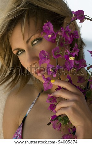 Woman with purple flowers - stock photo