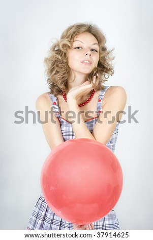 Woman  with red balloon