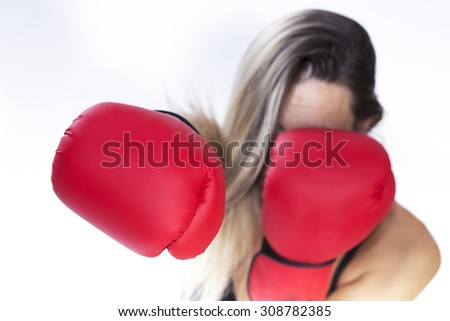 woman with red boxing gloves defending