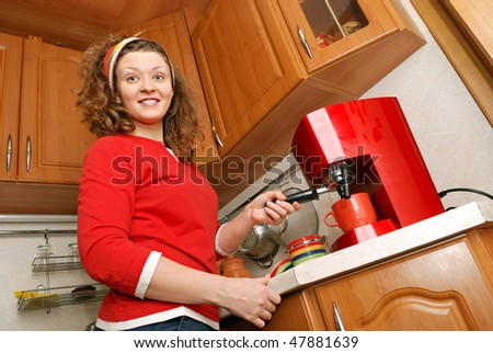 woman with red coffee machine