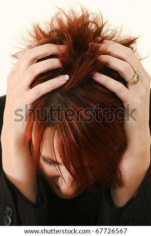 Woman with red hair and manicured hands in hair stressed or with headache or sad. - stock photo