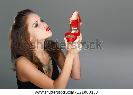 Woman with red high heels - stock photo