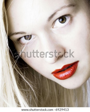 Woman with red lips and blond long hair