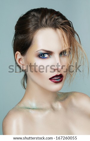 woman with red lips and blue cilia