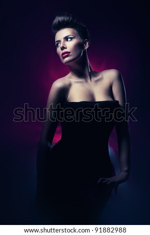 woman with red lips in dark magenta light - stock photo