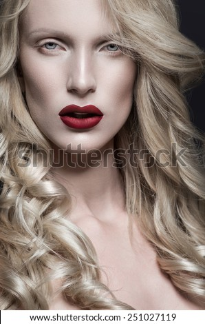 Woman with red lips, white hair and pale skin